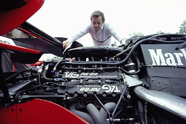 Hans Mezger inspects the Porsche TAG engine in a McLaren MP4-2.