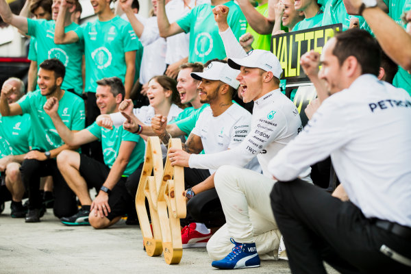 Red Bull Ring, Spielberg, Austria. Sunday 9 July 2017. Valtteri Bottas, Mercedes AMG, 1st Position, celebrates with Lewis Hamilton, Mercedes AMG, and the Mercedes team. World Copyright: Zak Mauger/LAT Images ref: Digital Image _54I1634