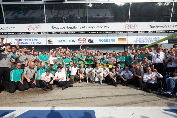 Autodromo Nazionale di Monza, Monza, Italy. Sunday 7 September 2014. Lewis Hamilton, Mercedes AMG, 1st Position, Nico Rosberg, Mercedes AMG, 2nd Position, Toto Wolff, Executive Director (Business), Mercedes AMG, Paddy Lowe, Executive Director (Technical), Mercedes AMG, and the Mercedes AMG team celebrate.  World Copyright: Steve Etherington/LAT Photographic. ref: Digital Image SNE28635