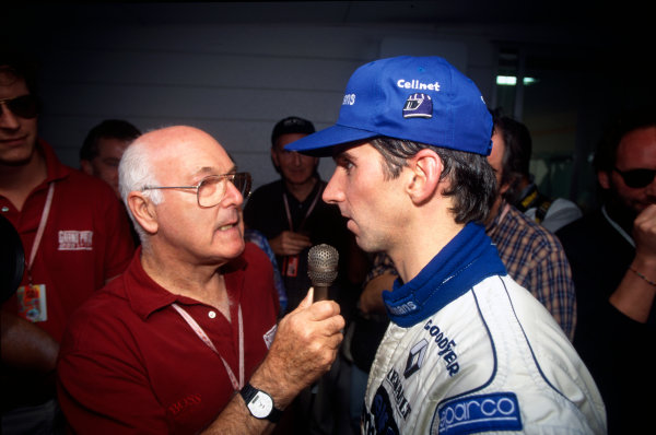 Suzuka, Japan. 11-13 October 1996.Damon Hill (Williams Renault) 1st position, is interviewed by Murray Walker before the race, portrait. World Copyright: LAT Photographic.Ref:  Colour Transparency