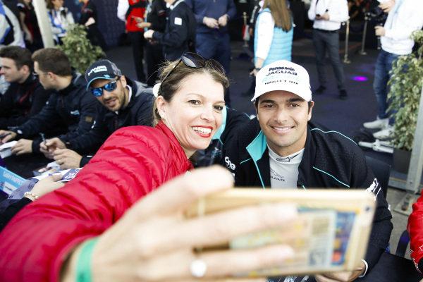 Nelson Piquet Jr. (BRA), Panasonic Jaguar Racing, poses for a photo with a fan