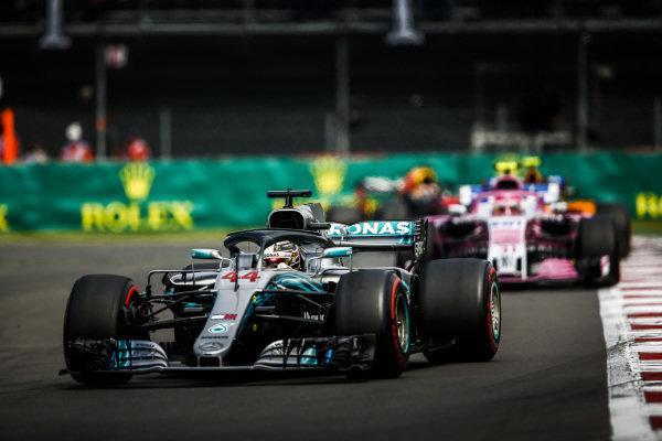 Lewis Hamilton, Mercedes AMG F1 W09 EQ Power+, leads Esteban Ocon, Racing Point Force India VJM11