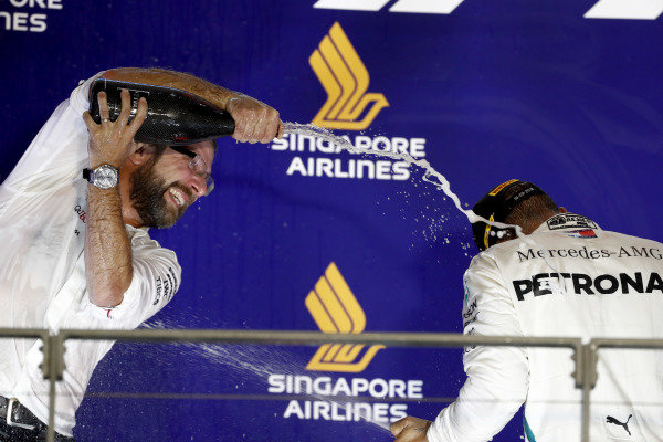 Lewis Hamilton, Mercedes AMG F1, 1st position, celebrates with a team mate on the podium