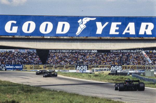 Rupert Keegan, Hesketh 308E Ford races ahead of Mario Andretti, Lotus 78 Ford as Gunnar Nilsson, Lotus 78 Ford chases down his team mate.