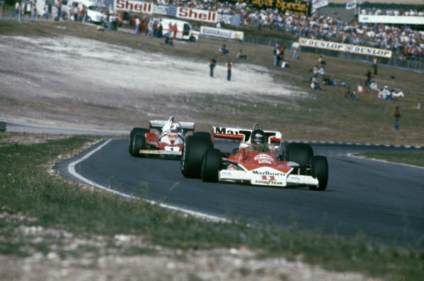 James Hunt, McLaren M23 Ford leads Niki Lauda, Ferrari 312T2.