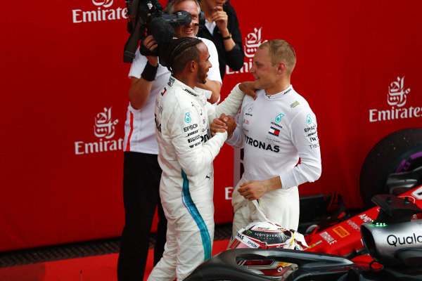 Lewis Hamilton, Mercedes AMG F1, is congratulated by Valtteri Bottas, Mercedes AMG F1.
