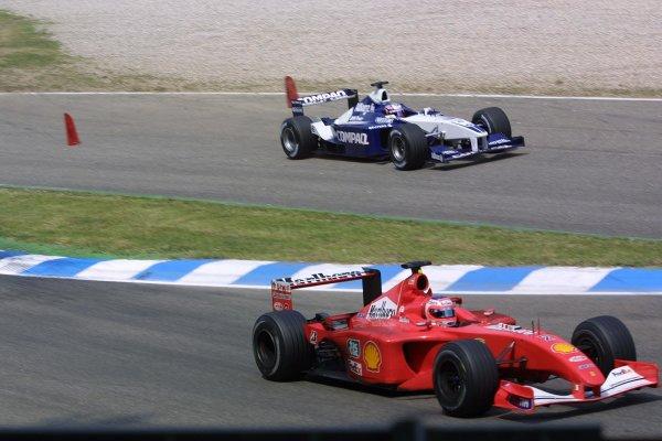 2001 German Grand Prix - RaceHockenheim, Germany. 29th July 2001Juan Pablo Montoya, BMW Williams FW23, runs wide as Rubens Barrichello, Ferrari F2001, takes the right line through the chicane.World Copyright - LAT PhotographicRef: 9 MB Digital File Only