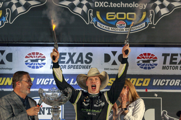 Josef Newgarden, Team Penske Chevrolet celebrates in victory lane with the traditional six-shooters
