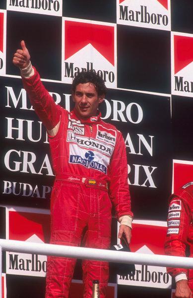 1992 Hungarian Grand Prix.Hungaroring, Budapest, Hungary.14-16 August 1992.Ayrton Senna (McLaren Honda) 1st position on the podium.Ref-92 HUN 04.World Copyright - LAT Photographic