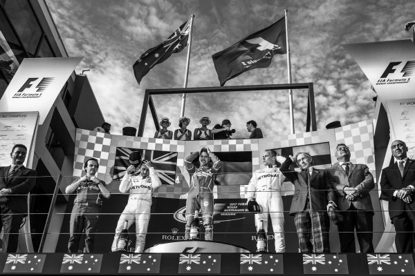 Lewis Hamilton (GBR) Mercedes AMG F1, Luigi Fraboni (ITA) Ferrari Head of Engine Trackside Operations, race winner Sebastian Vettel (GER) Ferrari and Valtteri Bottas (FIN) Mercedes AMG F1 celebrate on the podium with Jackie Stewart (GBR) at Formula One World Championship, Rd1, Australian Grand Prix, Race, Albert Park, Melbourne, Australia, Sunday 26 March 2017.
