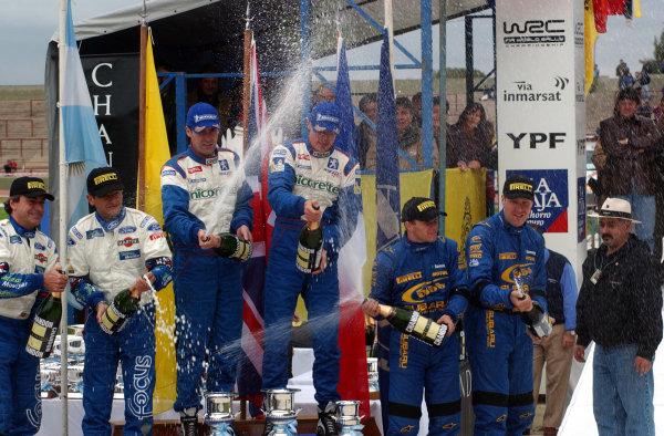 World Rally Championship, Rally of Argentina, May 16-19, 2002.The top three crews celebrate on the podium.Photo: Ralph Hardwick/LAT