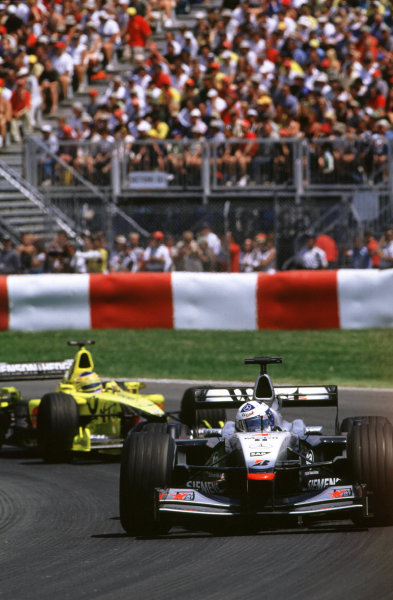 2001 Canadian Grand PrixMontreal, Canada. 8th-10th June 2001David Coulthard, West McLaren Mercedes MP4/16, leads Jarno Trulli, Jordan Honda EJ11, action.World Copyright: LAT Photographicref: 35mm Image A09