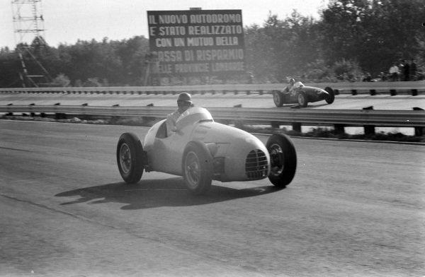 A Gordini T16, with Carlos Menditéguy, Maserati 250F, in the background.