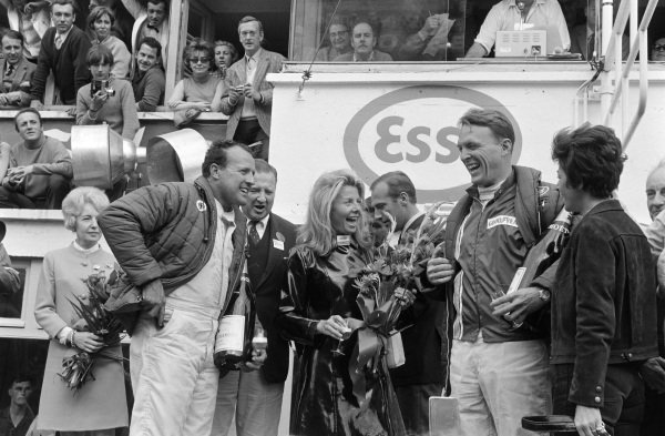 Dan Gurney / A.J. Foyt, Shelby-American, Ford GT40 Mk.IV, 1st position, celebrate victory, on the podium with Henry Ford II and his wife Maria.