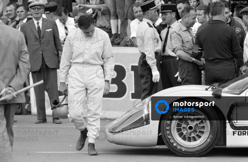 Bruce McLaren inspects his Ford GT40 Mk4.