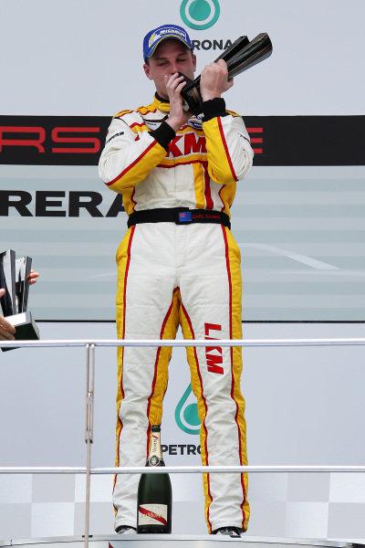 Race winner Earl Bamber (NZL) LKM Racing Team celebrates on the podium. Porsche Carrera Cup Asia, Sepang, Malaysia, 28-30 March 2014.