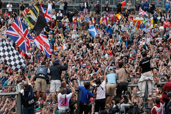 Silverstone Circuit, Northamptonshire, England. Sunday 5 July 2015. Lewis Hamilton, Mercedes AMG, 1st Position, celebrates with the fans. World Copyright: Andrew Ferraro/LAT Photographic ref: Digital Image _FER0448