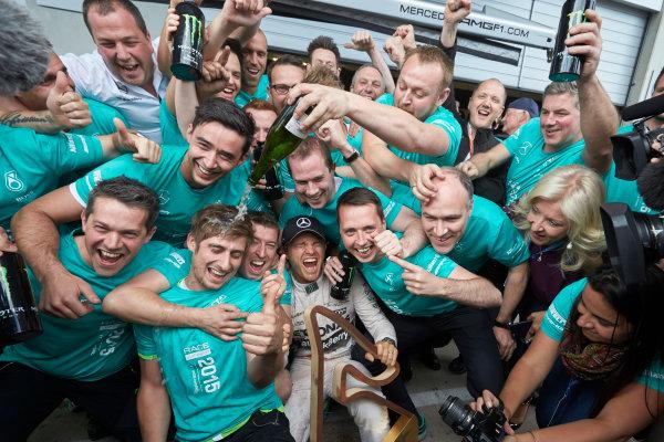Red Bull Ring, Spielberg, Austria. Sunday 21 June 2015. Nico Rosberg, Mercedes AMG, 1st Position, celebrates with his team. World Copyright: Steve Etherington/LAT Photographic. ref: Digital Image SNE25028