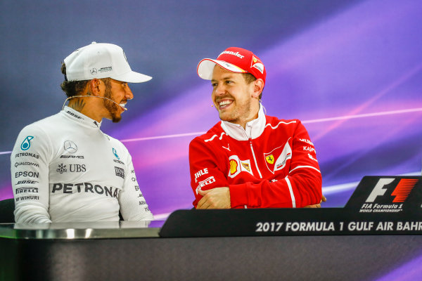 Bahrain International Circuit, Sakhir, Bahrain.  Sunday 16 April 2017. All smiles between Lewis Hamilton, Mercedes AMG, 2nd Position, and Sebastian Vettel, Ferrari, 1st Position, in the Press Conference. World Copyright: Sam Bloxham/LAT Images ref: Digital Image _W6I3401