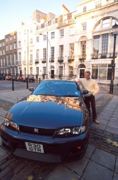 Johnny Herbert (GBR) with a Nissan Skyline GTR at home in London.
