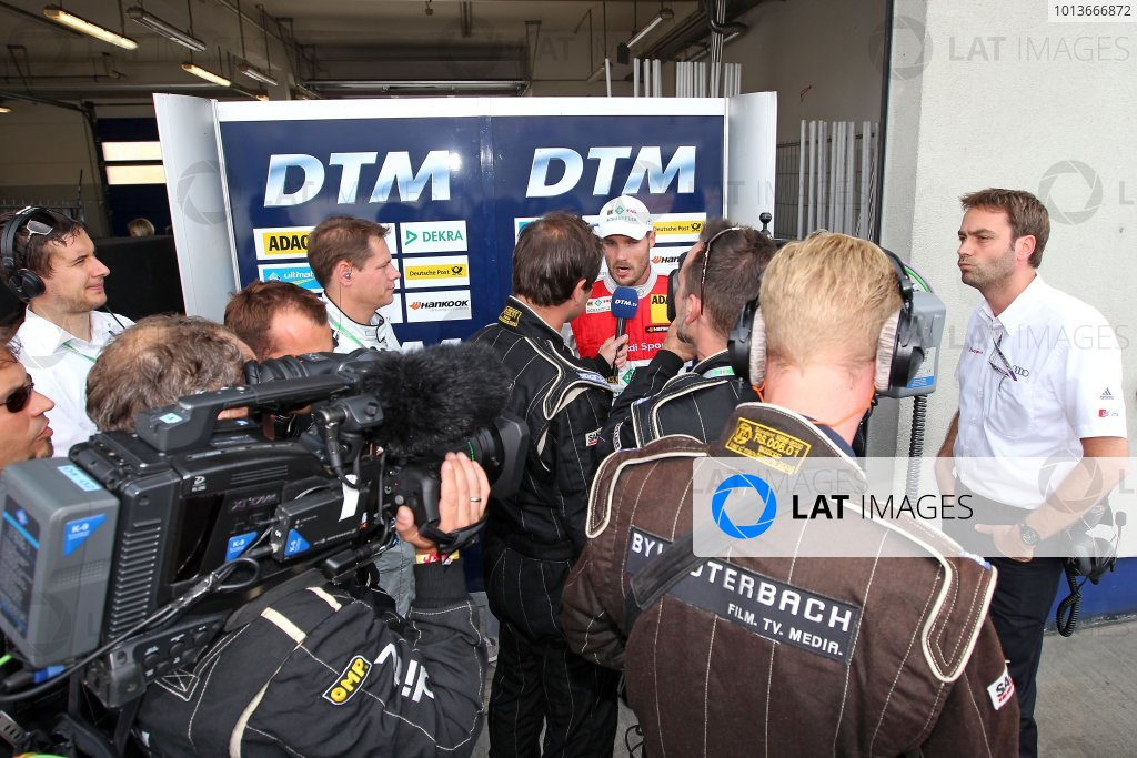 A disappointed championship leader Martin Tomczyk (GER), Audi Sport Team Phoenix, Schaeffler Audi A4 DTM (2008), explains his out in Q1 to the media.