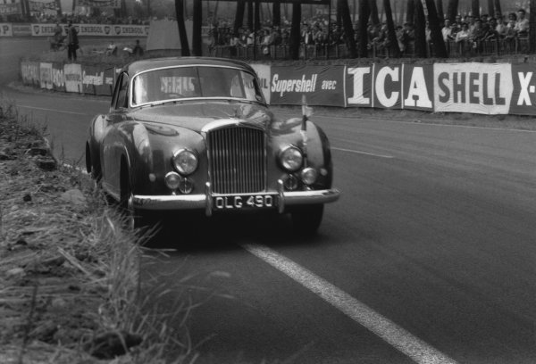 Le Mans, France. 20th - 21st June 1959 Walter Slater, the owner of of this Bentley Continental saloon, takes David Brown on a lap of the circuit during the race, action. World Copyright: LAT Photographic Ref: 578 - 10A-11.