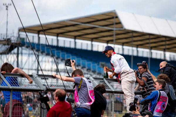 Silverstone, Northamptonshire, UK. Sunday 10 July 2016. Lewis Hamilton, Mercedes AMG, 1st Position, celebrates victory. World Copyright: Zak Mauger/LAT Photographic ref: Digital Image _79P8710