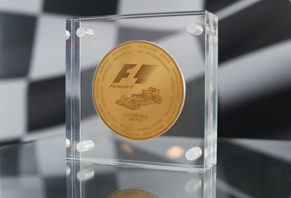 Silverstone, Northamptonshire, UK Friday 8 July 2016. Rosland Capital launch their unique, limited collection of gold and silver F1 coins, celebrating the history the FIA Formula One World Championship. A special edition 1/4oz British GP Gold Coin is announced, as well as the introduction of their 1kg F1 Gold Coin -  one of only 15 to be made this year. In addition, they are also launching two other F1 coins: a 2.5oz Silver Coin and 2.5oz Gold Coin. World Copyright: FerraroLAT Photographic ref: Digital Image _FER0155