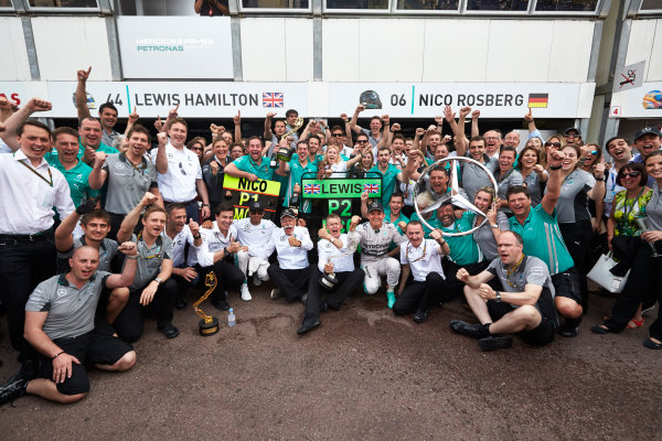 Monte Carlo, Monaco. Sunday 25 May 2014. Nico Rosberg, Mercedes AMG, 1st Position, Lewis Hamilton, Mercedes AMG, 2nd Position, Toto Wolff, Executive Director (Business), Mercedes AMG, Dr Dieter Zetsche, CEO, Mercedes Benz, Paddy Lowe, Executive Director (Technical), Mercedes AMG, and the Mercedes AMG team celebrate. World Copyright: Steve Etherington/LAT Photographic. ref: Digital Image SNE20202 copy