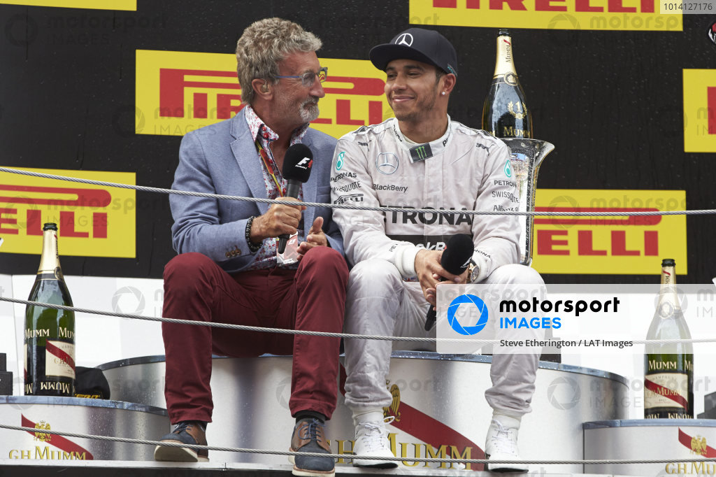 Circuit de Catalunya, Barcelona, Spain. Sunday 11 May 2014. Eddie Jordan, TV Pundit, BBC Sport F1, interviews Lewis Hamilton, Mercedes AMG, 1st Position, on the podium. World Copyright: Steve EtheringtonLAT Photographic. ref: Digital Image SNE15479 copy