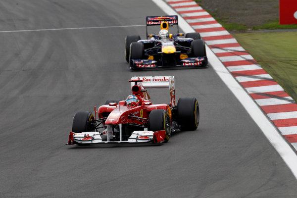 Nurburgring, Germany24th July 2011Fernando Alonso, Ferrari 150° Italia, 2nd position, leads Sebastian Vettel, Red Bull Racing RB7 Renault, 4th position. Action. World Copyright: Andrew Ferraro/LAT Photographicref: Digital Image _Q0C9894
