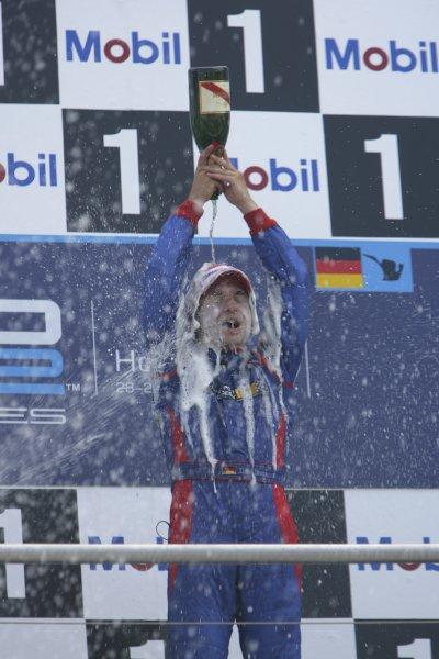2006 GP2 Series Round 8. Hockenheim, Germany. 30th July 2006. Sunday race. Timo Glock (GER, iSport International) race winer sprays champagne. Podium.World Copyright: Andrew Ferraro/GP2 Series Media Service. Ref: Digital Image Only.ZP9O8877 jpg