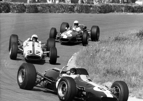 1966 Dutch Grand Prix.Zandvoort, Holland. 24 July 1966.Peter Arundell, Lotus 33-BRM, retired, leads Mike Spence, Lotus 33-BRM, 5th position, Bob Anderson, Brabham BT11-Climax, retired, action.World Copyright: LAT Photographic