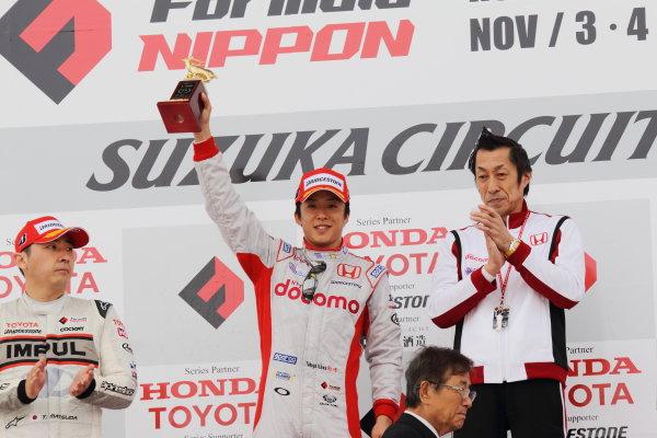 Suzuka Circuit, Japan. Rd 7 - 3rd - 4th November 2012. Race1 Winner Takuya Izawa ( #40 DOCOMO TEAM DANDELION RACING ) podium, portrait. World Copyright: Yasushi Ishihara/LAT Photographic ref: Digital Image 2012FN_Rd7_006