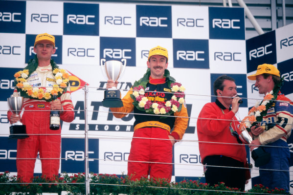 1998 National Saloon Car Cup. Silverstone, Great Britain. 11th July 1998. Rd 8. L to R: Toni Ruokonen (Honda Integra R), 2nd position, Andy Middlehurst (Nissan Primera GT), 1st position and being interviewed, Lionel Abbott (Saab 9.3), 3rd position, podium, portrait.  World Copyright: LAT Photographic.  Ref:  98NATSAL SIL1.