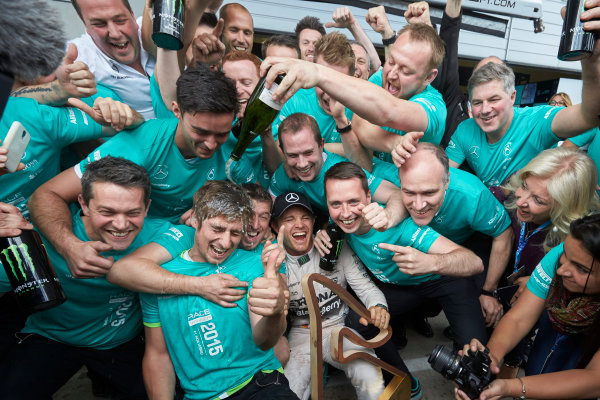 Red Bull Ring, Spielberg, Austria. Sunday 21 June 2015. Nico Rosberg, Mercedes AMG, 1st Position, celebrates with his team. World Copyright: Steve Etherington/LAT Photographic. ref: Digital Image SNE25032