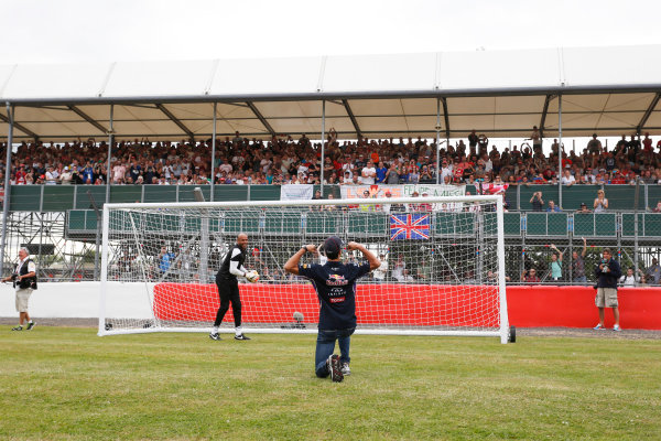 Silverstone, Northamptonshire, England. Thursday 3 July 2014. Daniel Ricciardo, Red Bull Racing, scores a goal during a feature for Sky Sports F1. World Copyright: Andrew Ferraro/LAT Photographic. ref: Digital Image _FER9769