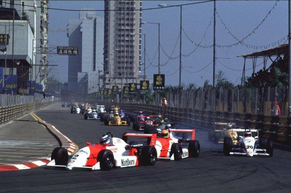 1990 Macau Formula 3 Grand Prix.  Macau, China. 25th November 1990. Mika Hakkinen leads Eddie Irvine and Michael Schumacher at the start of the race, action. World Copyright: LAT Photographic. Ref: 90F3MAC04.