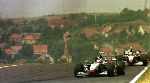 1998 Hungarian Grand Prix.Hungaroring, Budapest, Hungary.14-16 August 1998.Mika Hakkinen leads David Coulthard (McLaren MP4/13 Mercedes-Benz).World Copyright - LAT Photographic