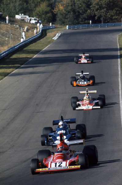 Niki Lauda, Ferrari 312B3 leads Jody Scheckter, Tyrrell 007 Ford and Emerson Fittipaldi, McLaren M23 Ford.