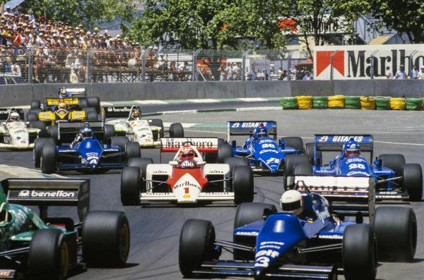 Niki Lauda, McLaren MP4-2B TAG, battles with Philippe Streiff, Ligier JS25 Renault, Jacques Laffite, Ligier JS25 Renault, and Ivan Capelli, Tyrrell 014 Renault, in his final grand prix start.