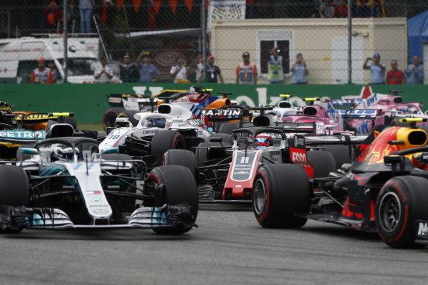 Max Verstappen, Red Bull Racing RB14 Tag Heuer, leads Valtteri Bottas, Mercedes AMG F1 W09, and Romain Grosjean, Haas F1 Team VF-18 Ferrari.