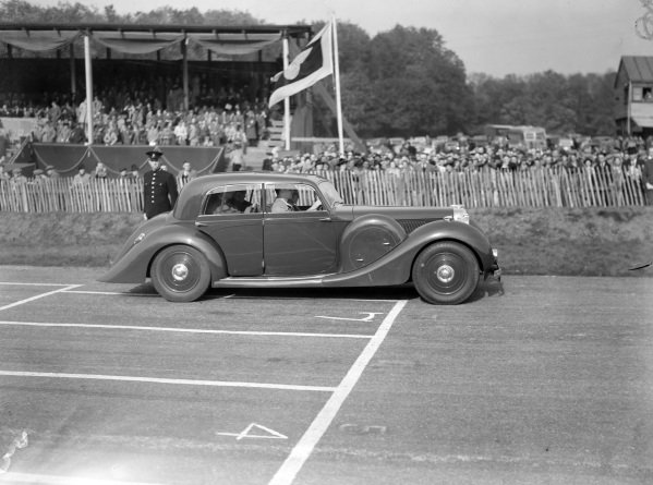 Richard Seaman takes HRH Duke of Kent for two laps of the track in a Lagonda V12.