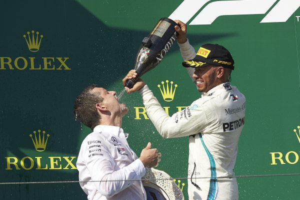 Riccardo Mosconi Mercedes-AMG F1 receives some Champagne refreshment from Lewis Hamilton, Mercedes AMG F1, 1st position, on the podium.