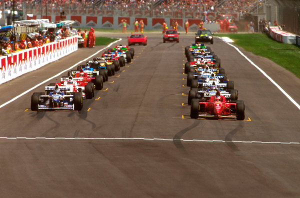 Imola, Italy.3-5 May 1996.Michael Schumacher (Ferrari F310) on pole, next to rival Damon Hill (Williams FW18 Renault) on the front row of the grid at the start.Ref-96 SM 15.World Copyright - LAT Photographic