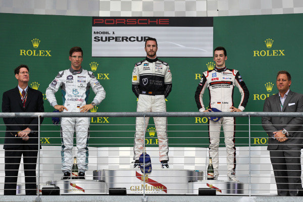 (L to R): Second placed Michael Ammermuller (GER) Lechner Racing Middle East, race winner Alex Riberas (ESP) Lechner Racing Team Seattle and third placed Sven Muller (GER) Lechner Racing Middle East on the podium at Porsche Supercup, Rd8, Austin, Texas, USA, 23-25 October 2015.