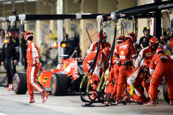 Sebastian Vettel (GER) Ferrari SF15-T pitstop at Formula One World Championship, Rd19, Abu Dhabi Grand Prix, Race, Yas Marina Circuit, Abu Dhabi, UAE, Sunday 29 November 2015.