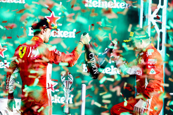 Sebastian Vettel, Ferrari, 2nd position, and Kimi Raikkonen, Ferrari, 3rd position, celebrate on the podium