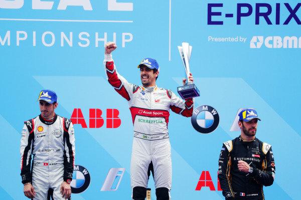Lucas Di Grassi (BRA), Audi Sport ABT Schaeffler, celebrates on the podium with Sébastien Buemi (CHE), Nissan e.Dams, andJean-Eric Vergne (FRA), DS TECHEETAH