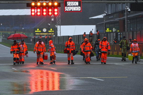Marshals on the circuit after the race